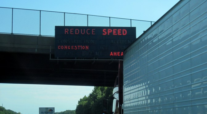 REDUCE SPEED: These neon signs used to be all over the New Jersey Turnpike. Photo by Ian Ligget.