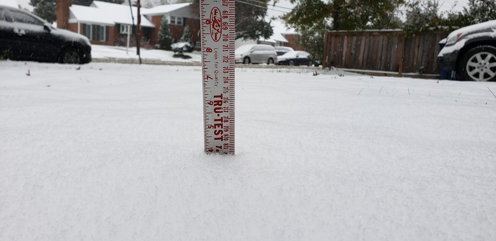 Nearly 4 inches of snow had accumulated in Alexandria, Va.'s West End as a early season snow storm hit the Washington, D.C. area